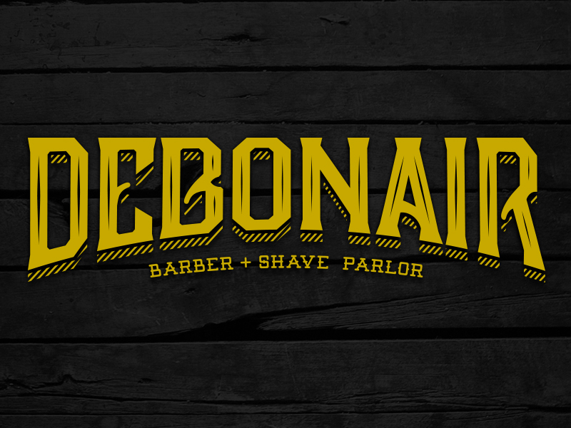 What are the two fonts used in this barbershop logotype
